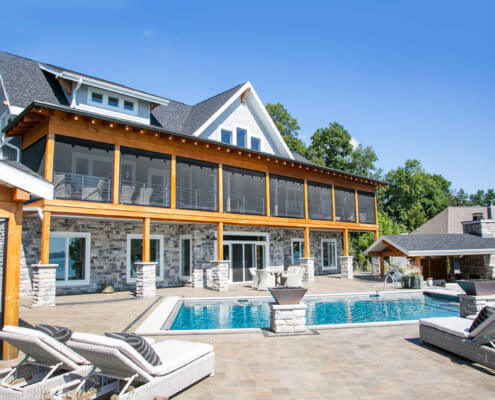 lakefront home with swimming pool
