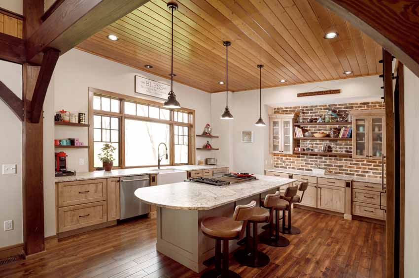 Kitchen with White Persia Suede Countertops and Two-Toned Painted Cabinetry