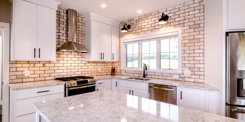 farmhouse style kitchen with brick backsplash