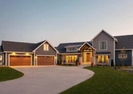 traditional hybrid style home at dusk