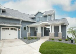 blue sided home with white trim