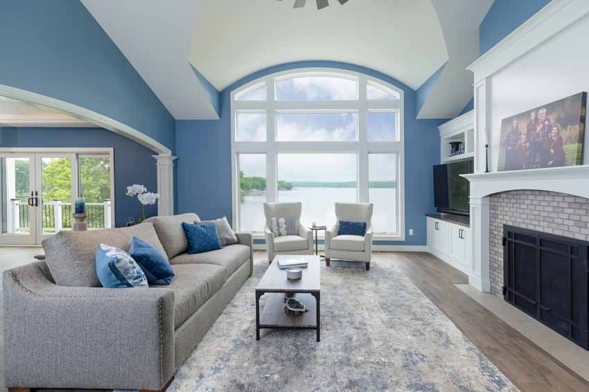 great room with large arched window overlooking the lake