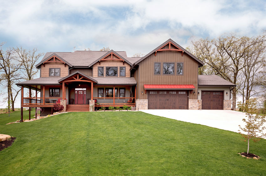 timber frame home with red accents